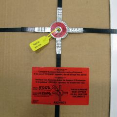 Topp Clip components: metal clip, plastic seal, and tamper-evident label